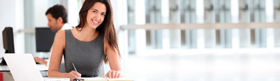 Attractive businesswoman working on laptop computer